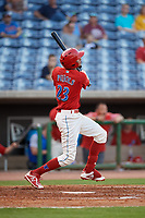 Clearwater Threshers right fielder Jose Pujols (23) follows through on a swing during a game against the Jupiter Hammerheads on April 9, 2018 at Spectrum Field in Clearwater, Florida.  Jupiter defeated Clearwater 9-4.  (Mike Janes/Four Seam Images)