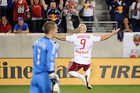 Luke Rodgers (9) of the New York Red Bulls celebrates scoring a penalty kick on Portland Timbers goalkeeper Troy Perkins (1). The New York Red Bulls defeated the Portland Timbers 2-0 during a Major League Soccer (MLS) match at Red Bull Arena in Harrison, NJ, on September 24, 2011.