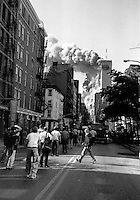 USA. NYC. 9/11/2001. Collapse of the first tower from West Broadway in SoHo after terrorist attack on the World Trade Center.