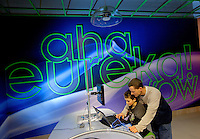 "Charlotte, NC on-location photography of Discovery Place, Charlotte's hands-on science museum located in downtown Charlotte NC. In this image, kids check out the ""Explore More Stuff Lab,"" a lab-like environment where matter and energy are explored and tested."