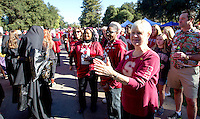 Fans cheers on the Leland Stanford marching band as they perform before Saturday, November 23, 2013, Big Game at Stanford University.