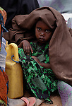 A Somali girl takes shelter from the sun as her family waits to be assigned a new tent in an extension of the world's largest refugee settlement. Swelled with tens of thousands of recent arrivals fleeing drought in Somalia, the Dadaab camp in northeastern Kenya has been unable to absorb the newest arrivals. The Lutheran World Federation, a member of the ACT Alliance, is manager of the camp and in July began moving hundreds of families into tents in the extension.