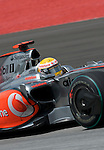 04 Apr 2009, Kuala Lumpur, Malaysia --- Vodafone McLaren Mercedes F1 Team driver Lewis Hamilton of Great Britain steers his car during the third practice session ahead the 2009 Fia Formula One Malasyan Grand Prix at the Sepang circuit near Kuala Lumpur. Photo by Victor Fraile --- Image by © Victor Fraile / The Power of Sport Images