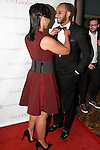 "Singer Alicia Keys adjusts her husband Kasseem ""Swizz Beatz"" Dean's bow tie on the red carpet, at the Gordon Parks Foundation 2014 Award Dinner and Auction on June 3, 2014 at Cipriani Wall Street, located on 55 Wall Street."