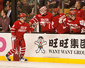 Ryan Cloonan (BU - 8), Connor Lacouvee (BU - 30), Nick Roberto (BU - 15), Larry Venis (BU - Assistant Director-Athletic Training Services), Bobo Carpenter (BU - 14) - The Boston University Terriers defeated the Boston College Eagles 3-1 in their opening Beanpot game on Monday, February 6, 2017, at TD Garden in Boston, Massachusetts.