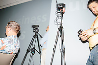 Video cameras stand on tripods as former Pennsylvania senator and Republican presidential candidate Rick Santorum speaks at a town hall event at the Concord office of New England College in Concord, New Hampshire.
