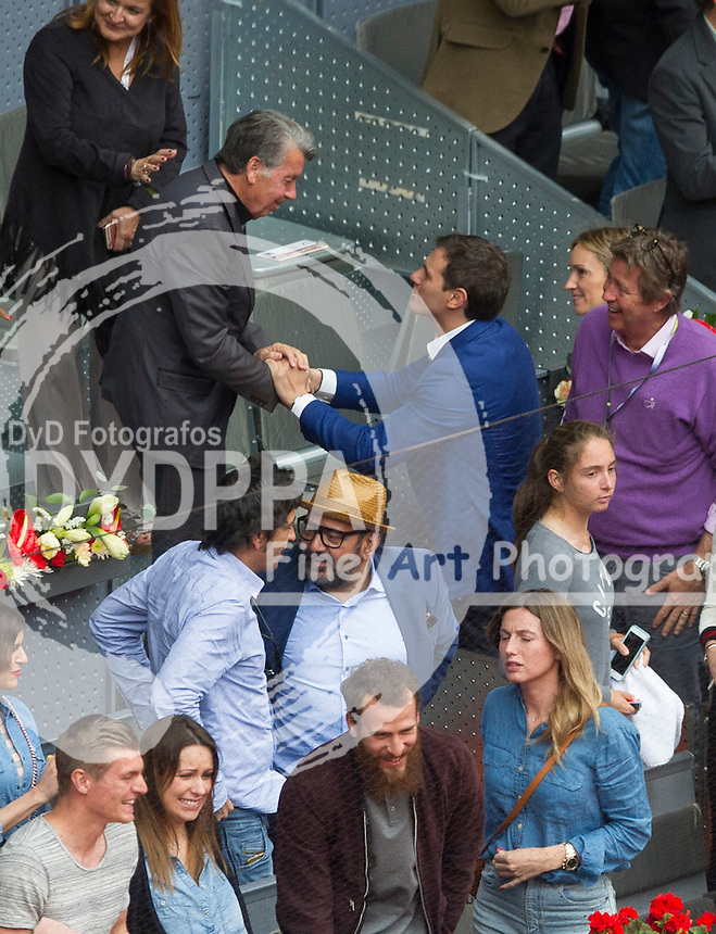 Spanish C's political party leader Albert Rivera (blue) greets Manolo Santana; Real Madrid's German midfielder Toni Kroos (L) and his couple Jessica Farber (2nd L); Real Madrid's basketball player Chacho Rodriguez (3rd L) and wife Ana Bernal