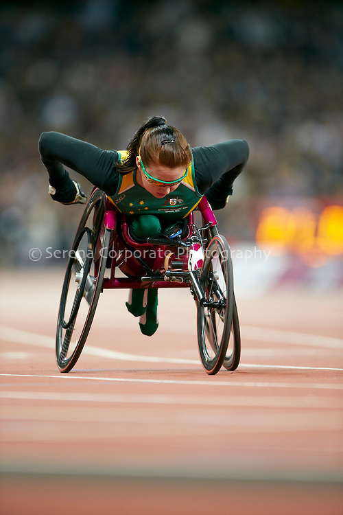 Angela Ballard does a quick warm up lap prior to the start of the women's T53 200m final at the London Paralympic Games - Athletics 6.9.12