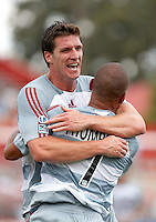 FC Dallas forward Kenny Cooper celebrates with FC Dallas forward Abe Thompson (7) after Thompson's goal.  Houston Dynamo beat FC Dallas 2-1 at Robertson Stadium in Houston, TX on June 3, 2007.