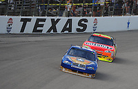 Nov. 8, 2009; Fort Worth, TX, USA; NASCAR Sprint Cup Series driver Kurt Busch leads Jeff Gordon during the Dickies 500 at the Texas Motor Speedway. Mandatory Credit: Mark J. Rebilas-