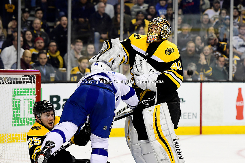 March 29, 2018: Boston Bruins goaltender Tuukka Rask (40) fights with Tampa Bay Lightning center Cory Conacher (89) during the NHL game between the Tampa Bay Lightning and the Boston Bruins held at TD Garden, in Boston, Mass. Boston defeats Tampa Bay 4-2. Eric Canha/CSM
