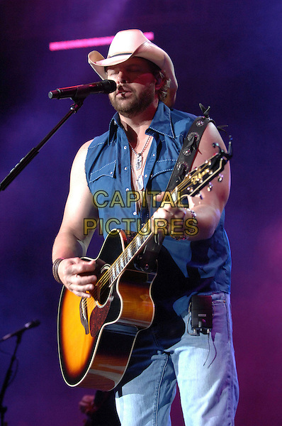 TOBY KEITH.Performs during his Big Dog Daddy Tour at Walnut Creek Amphitheatre, Raleigh, North Carolina, USA..June 23rd, 2007.stage concert live performance gig music half length blue sleeveless top stetson guitar singing .CAP/ADM/MO.© Moose/AdMedia/Capital Pictures