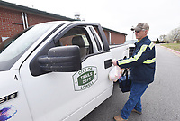 MEALS TO GO<br />Rodney Judy, a Lowell public works employee, heads out to deliver Meals on Wheels on Wednesday March 18 2020 prepared at the Lowell Senior Activity Center. Lowell city employees are helping to deliver the meals by filling in for staff and volunteers who are absent during the caronavirus outbreak. Patrons of the seven senior centers operated by the Office of Human Concern in Benton, Madison or Carroll counties may pick up a meal to go by stopping at the door of a center, said John Whiting, food services director for the seven centers. A meal will be brought out to them. Go to nwaonline.com/200319Daily/ to see more photos.<br />(NWA Democrat-Gazette/Flip Putthoff)