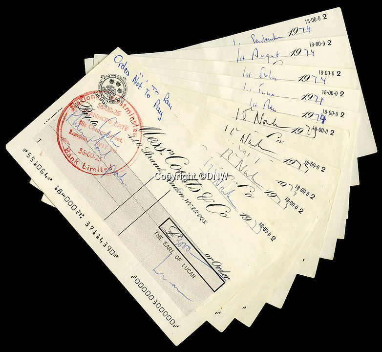 BNPS.co.uk (01202 558833)<br /> Pic: DNW/BNPS<br /> <br /> A series of bounced cheques that dramatically illustrate the scale of Lord Lucan's gambling debts before he disappeared following the murder of <br /> the family nanny have come to light after 42 years.<br /> <br /> The troubled aristocrat signed the 11 cheques totalling almost £20,000 – about £250,000 today – as he desperately tried to reverse his spiralling losses at a leading London casino. <br /> <br /> The cheques are being sold by London auctioneers Dix Noonan Webb.