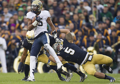 November 03, 2012:  Pittsburgh wide receiver Devin Street (15) runs for yardage as Notre Dame inside linebacker Manti Te'o (5) defends during NCAA Football game action between the Notre Dame Fighting Irish and the Pittsburgh Panthers at Notre Dame Stadium in South Bend, Indiana.  Notre Dame defeated Pittsburgh 29-26 in three overtimes.