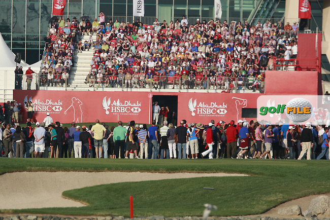 Huge crowds watch Luke Donald (ENG), Tiger Woods (USA) and Rory McIlroy (NIR) on the 18th hole during Friday's Round 2 of the HSBC Golf Championship at the Abu Dhabi Golf Club, United Arab Emirates, 27th January 2012 (Photo Eoin Clarke/www.golffile.ie)