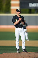 Wake Forest Demon Deacons relief pitcher Rayne Supple (30) rubs up the baseball during the game against the Florida State Seminoles at David F. Couch Ballpark on April 16, 2016 in Winston-Salem, North Carolina.  The Seminoles defeated the Demon Deacons 13-8.  (Brian Westerholt/Four Seam Images)