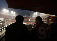 Ohio State linebacker Joey Bosa talks to a teammate as they watch the rain delay the start of the Reds/Pirates game at Great American Ball Park on Wednesday April 8, 2015. (Dispatch photo by Jonathan Quilter)