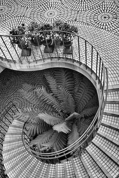 Black and white of circular staircase emphasizing the pattern and shapes