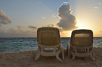 Sun lounger on tropical beach at sunrise, Punta Cana, Dominican Republic