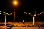 "A runner waits the ""19th Korrika"" early in Lodosa on March 26, 2015, Basque Country. The ""19th Korrika"" a relay of hand to hand baton passing without interruption over 11 days and 10 nights crossing many Basque villages and cities, totalling some 2300 kilometres in a bid to promote the basque language.The ""Korrika"" this year end in Bilbao on March 29. (Ander Gillenea / Bostok Photo)"