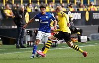 16th May 2020, Signal Iduna Park, Dortmund, Germany; Bundesliga football, Borussia Dortmund versus FC Schalke;  FC Schalke's  Alessandro Schöpf  takes on BVB Julian Brandt