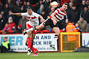 Chris Brown of Doncaster and Darius Charles of Stevenage challenge for a header. Stevenage v Doncaster Rovers - npower League 1 -  Lamex Stadium, Stevenage - 12th January, 2013. © Kevin Coleman 2013.