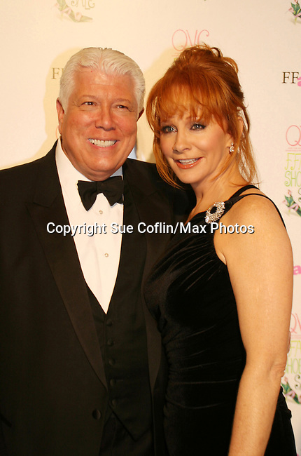 """Country Singer Reba McEntire poses with Dennis Basso at the 15th Annual QVC presents """"FFANY Shoes on Sale"""" which benefits Breast Cancer Research on October 15, 2008 at the Waldorf Astoria, New York City, New York. (Photo by Sue Coflin/Max Photos)"""
