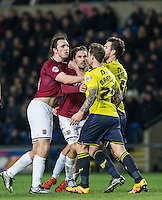 John-Joe O'Toole of Northampton Town & Chris Maguire of Oxford United clash during the Sky Bet League 2 match between Oxford United and Northampton Town at the Kassam Stadium, Oxford, England on 16 February 2016. Photo by Andy Rowland.