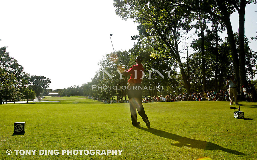 2 August 2009: Tiger Woods watches his drive off the 18th hole tee in the final round of the Buick Open PGA Tour golf tournament, at Warwick Hills Golf & Country Club, in Grand Blanc, MI. Tiger Woods won the tournament with 20 under par in four rounds...***** Editorial Use Only *****