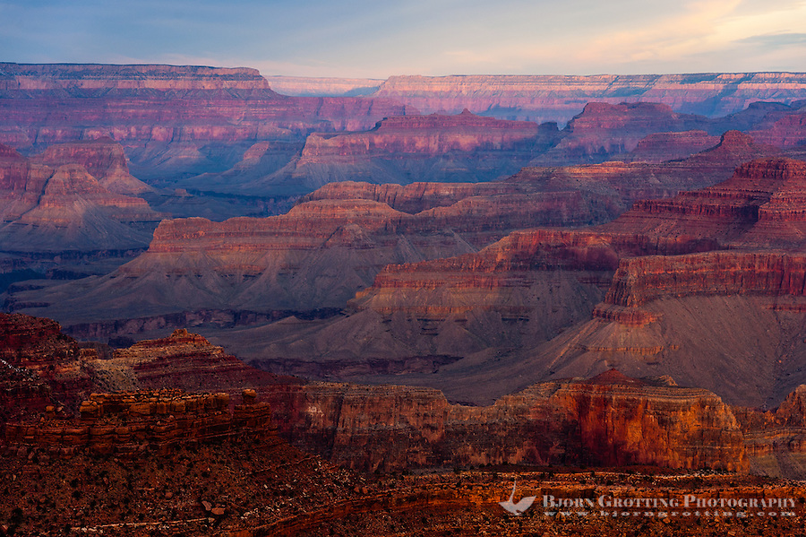 United States, Arizona, Grand Canyon. Sunrise at Yavapai Point. The morning sun colours everything red.