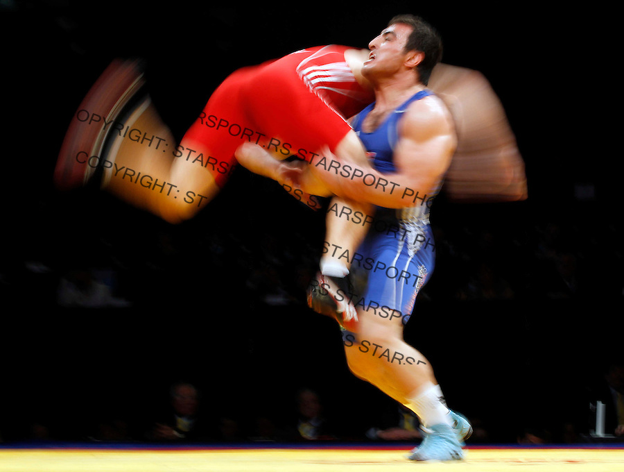 BELGRADE, SERBIA - MARCH 09: Long time exposure of Serdar Boke of Turkey (R) competes for the bronze medal with Gheorghita Stefan of Romania (L) of Men's Freestyle 84kg during the European wrestling championship March 09, 2011 in Belgrade, Serbia.(Photo by Srdjan Stevanovic/Getty Images)