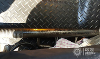 Pictured: A large metal bar discovered by police in the yard where the unidentified man was kept in a caravan.<br /> Re: A father and son have been sentenced for keeping a man as a slave for two years by Swansea Crown Court, Wales, UK.<br /> Anthony Howard Baker, 49, and his son Harvey Baker, 19, from Jersey Marine, near Neath, were also jointly charged with six counts of causing actual bodily harm.