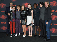 Ted Sarandos, Noah Schnapp, Gaten Matarazzo, Millie Bobby Brown, Sadie Sink, Caleb McLaughlin, Finn Wolfhard &amp; Cindy Holland at the premiere for Netflix's &quot;Stranger Things 2&quot; at the Westwood Village Theatre. Los Angeles, USA 26 October  2017<br /> Picture: Paul Smith/Featureflash/SilverHub 0208 004 5359 sales@silverhubmedia.com