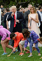 United States President Donald Trump blows a whistle to start an egg roll  as First Lady Melania Trump looks on during the annual Easter Egg Roll on the South Lawn of the White House  in Washington, DC, on April 17, 2017. <br /> CAP/MPI/CNP/RS<br /> &copy;RS/CNP/MPI/Capital Pictures