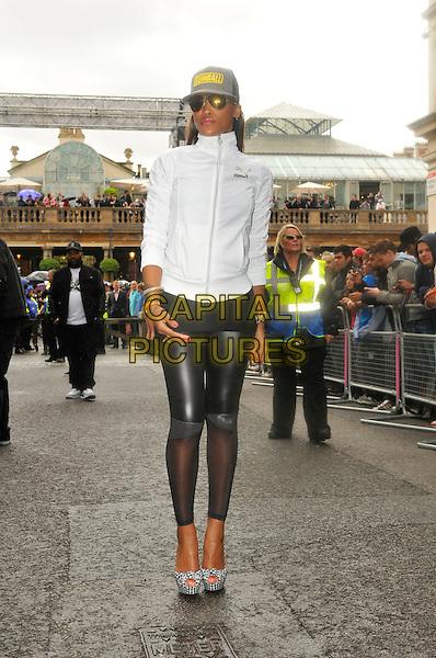 EVE (Eve Jihan Jeffers).The start of Gumball 3000, Covent Garden, London, England. .May 26th, 2011.full length black leather sheer leggings white top baseball cap hat sunglasses shades platform shoes pep toe .CAP/CAS.©Bob Cass/Capital Pictures.