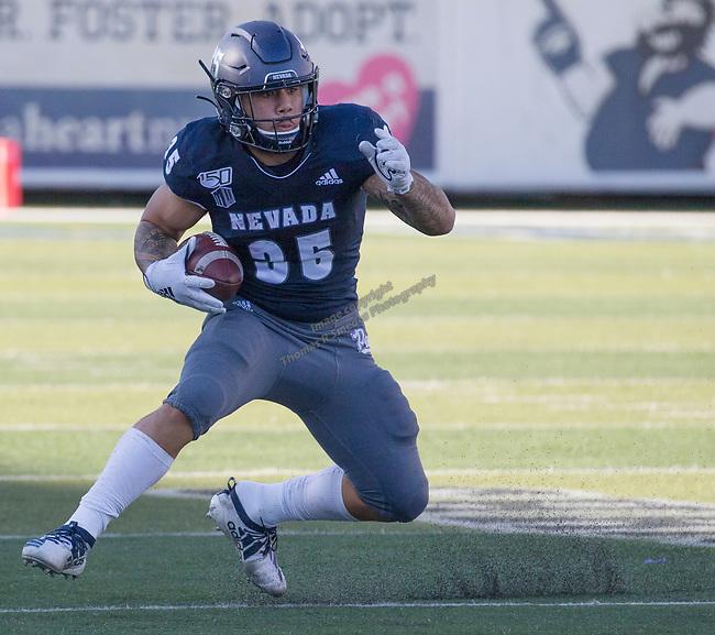 Nevada's Toa Taua (35) runs in the Nevada vs Weber State football game in Reno, Nevada on Saturday, Sept. 14, 2019.