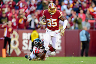Landover, MD - November 4, 2018: Washington Redskins tight end Vernon Davis (85) is tackled by Atlanta Falcons cornerback Robert Alford (23) but not before he picks up a first down at FedEx Field in Landover, MD. The Falcons defeated the Redskins 38-13. (Photo by Phillip Peters/Media Images International)