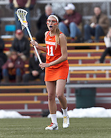 Syracuse University midfielder Amy Cross (11) looks to pass.  Syracuse University (orange) defeated Boston College (white), 17-12, on the Newton Campus Lacrosse Field at Boston College, on March 27, 2013.