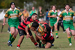 Nau Tapui gets taken to ground by Arron Angareu & John Tamalii. Counties Manukau Premier Club Rugby Game of the Week between Drury & Papakura, played at Drury Domain on Saturday Aprill 11th, 2009..Drury won 35 - 3 after leading 15 - 5 at halftime.