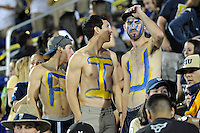 25 October 2011:  FIU fans, complete with body paint, wait for play to resume in the third quarter as the FIU Golden Panthers defeated the Troy University Trojans, 23-20 in overtime, at FIU Stadium in Miami, Florida.