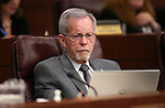 Nevada Assemblyman Glenn Trowbridge, R-Las Vegas, works in committee at the Legislative Building in Carson City, Nev., on Monday, March 2, 2015. <br /> Photo by Cathleen Allison
