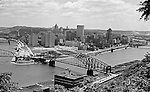 Pittsburgh PA:  View from Mt Washington looking over the Point Bridge at Gateway Center and construction of the PA State Office Building - 1955
