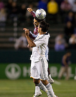 LA Galaxy defender Ante Jazic (4) and Colorado Rapids forward Herculez Gomez (16) battle in the air for a ball late in the second half. The Colorado Rapids defeated the LA Galaxy 1-0 during the preliminary rounds of the 2008 US Open Cup at Home Depot Center stadium in Carson, Calif., on Tuesday, May 27, 2008.