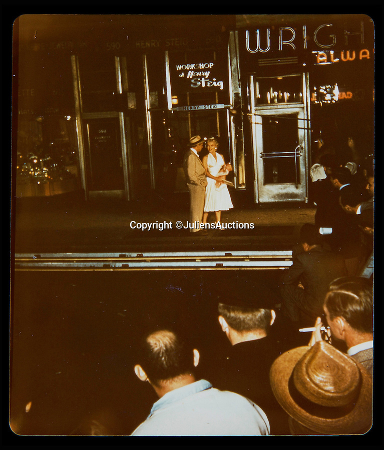 BNPS.co.uk (01202 558833)<br /> Pic: JuliensAuctions/BNPS<br /> <br /> A never before seen photo of Marilyn Monroe and co-star Tom Ewell on the set for The Seven Year Itch, filming the now famous skirt-blowing subway scene.<br /> <br /> A huge archive of candid photographs of screen siren Marilyn Monroe taken by a superfan she befriended has emerged for sale for a staggering £320,000.<br /> <br /> The collection includes more than 550 colour and black and white snaps, some of which have never been seen before, that were taken by fan-turned-friend Freda Hull.<br /> <br /> Monroe was notoriously guarded but welcomed Mrs Hull and her five friends into her inner sanctum, often giving them gifts and even once inviting them for a picnic at her home in Connecticut.<br /> <br /> The archive, which also boasts 150 colour slides, 750 stills from Monroe's films and a collection of personal home movies, is tipped to fetch £320,000 when it goes under the hammer at Julien's Auctions.