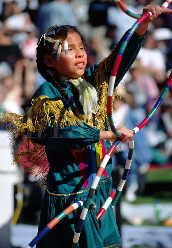 A young girl competes at the WORLD CHAMPIONSHIP HOOP DANCE CONTEST - HEARD MUSEUM, PHOENIX, ARIZONA