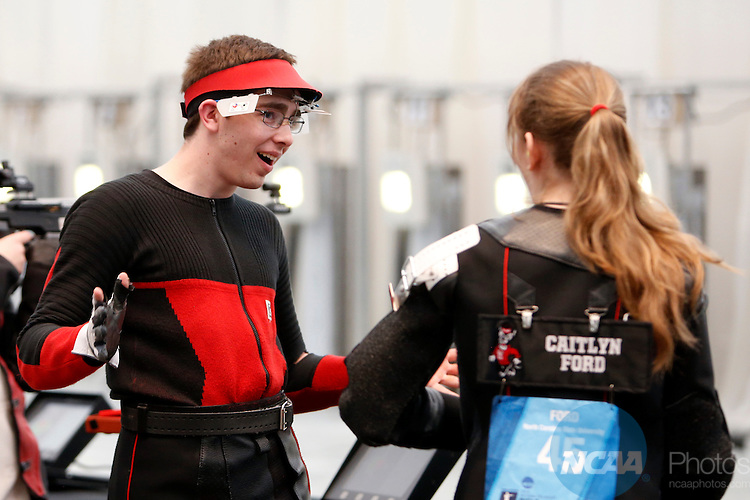 12 MAR 2016:  Lucas Kozeniesky, left, of North Carolina State University, reacts to finishing his round during the NCAA Division I Men's and Women's Rifle Championship held at the Stile Athletics Field House in Akron, OH.  Kozeniesky finished fifth in the competition with a final score of 143.  Jay LaPrete/NCAA Photos