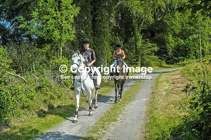 Two riders on a trail at Castleward, the National Trust property near Strangford, Co Down, N Ireland. Ref: 200408015322<br />