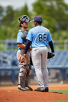 Tampa Bay Rays pitcher Jose Lopez (86) in a mound visit with catcher Erik Ostberg (41) during a Florida Instructional League game against the Baltimore Orioles on October 1, 2018 at the Charlotte Sports Park in Port Charlotte, Florida.  (Mike Janes/Four Seam Images)
