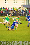 St Mary's Paul O'Donoghue looses possession under pressure from Skellig Rangers Aidan O'Sullivan & Colm Martin.